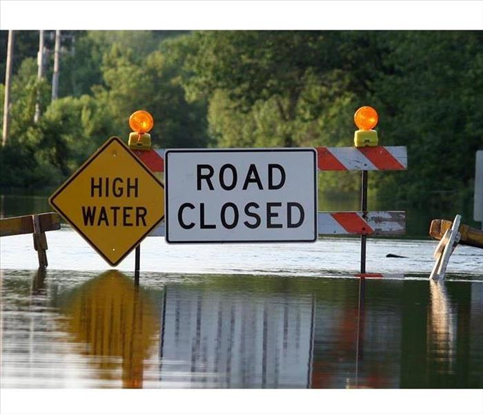 flooded road and sign