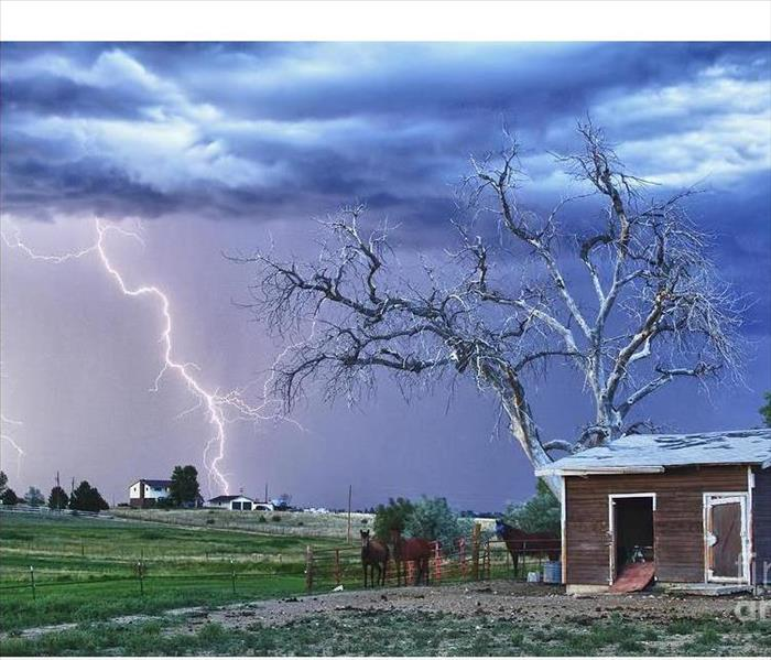 house with lightning behind it