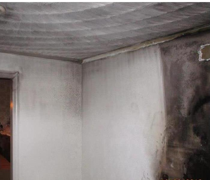picture of room being cleaned from soot